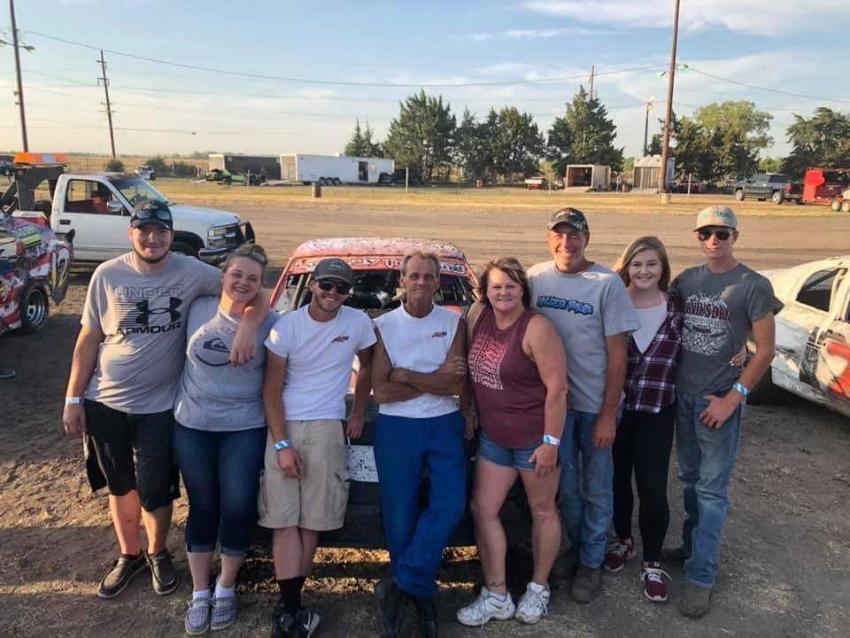 """A HISTORIC NIGHT: It's been 37 years in the making for veteran wheelman Mike Earll as he earned his first feature win of his career on Saturday, Sept. 5 at Lincoln County Raceway. Earll was in disbelief as he stepped out of his car onto the straightaway for his feature picture telling the flagman, """"I don't know what I'm supposed to do here."""" The fans rejoiced for Earll's victory as it was a tough-earned one. Pictured is Earll surrounded by his family and supporters at the raceway."""