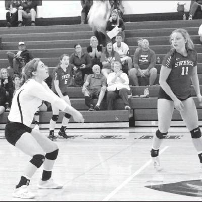 GOTHENBURG LIBERO Jaiden Davis (12) bumps the ball during the Hershey Tournament in late September. Davis compiled 400 digs this season, and she transformed into the best player at her position in the Southwest Conference. Fellow Swede and all-SWC player
