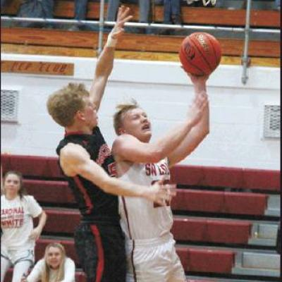 GOTHENBURG'S MAGUIRE BARTLETT drives toward the basket for two of his 14 points as the Swedes defeated McCook 66-61 in Southwest Conference play last Friday. (Photo by Eric Viccaro)
