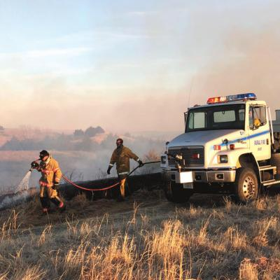 JOINT EFFORT TO PUT OUT FAST MOVING FLAMES