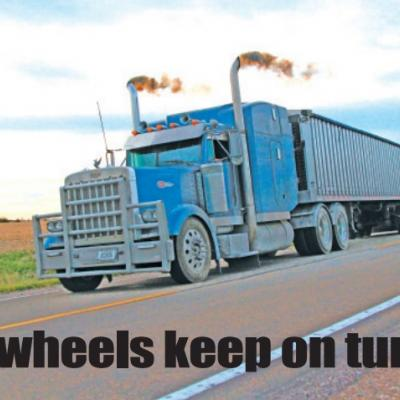 """ON THE ROAD AGAIN: While many trucks that haul livestock or grain have had workloads slowed, freight haulers with supplies deemed """"essential"""" are staying busy. New Nebraska DOT regulations have been put into place to help drivers be able to continue to work."""