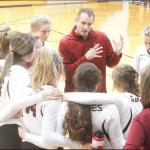 GOTHENBURG HIGH SCHOOL head volleyball coach Bryson Mahlberg motions to Swedes players during a timeout at the Holdrege Triangular back in October. Mahlberg was recently honored by the American Volleyball Coaches Association as one of its Thirty Under 30