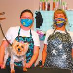 "Kaitlin Smith and Alissa Plenty Chief work hard to groom the pups that visit the shop that many remember as ""Sweets and Treats"". The business also sells a plethora of treats and pet knick knacks."